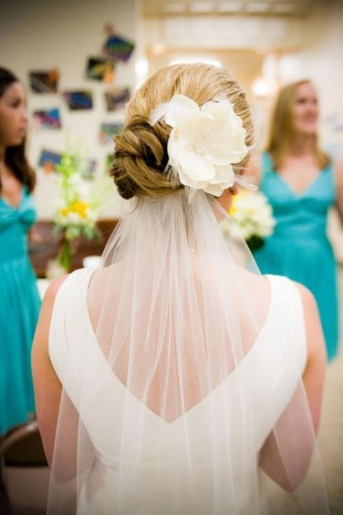 Свадебная прическа с цветком фото 15
