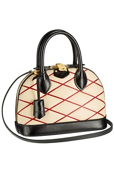 бежевая с черным сумка  от Louis Vuitton